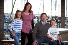 Murray and Julie Benns with their children Luke (8) and Adele (10) at Pine Harbour Marina. Photo / Natalie Slade