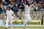 New Zealand bowler Tim Southee celebrates taking the wicket of India's captain Mahendra Singh Dhoni. Photo / AP