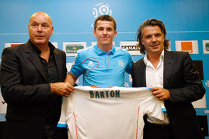 A private jet took Joey Barton (centre) from Fleetwood Town to a new life in Marseilles. Photo / AP