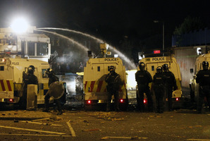 Police use a water cannon on loyalist rioters in North Belfast, Northern Ireland. Photo / AP