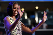 First Lady Michelle Obama waves as she appears at the podium for a camera test ahead of the Democratic National Convention. Photo / AP