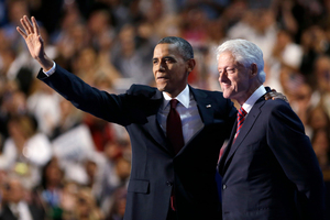 President Barack Obama waves after Former President Bill Clinton spoke at the Democratic National Convention. Photo / AP