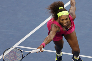 Serena Williams returns a shot to Italy's Sara Errani. Photo / Mike Groll