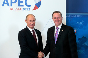 Russian President Vladimir Putin greets New Zealand Prime Minister John Key at the APEC summit in Vladivostok, Russia. Photo / AP