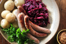 Braised red cabbage with sausage and potatoes. Photo / Doug Sherring