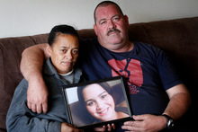 Lesley and Kevin Fenton at home with a photo of daughter Hayley-Ann.  Photo / Christine Cornege