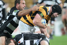 Michael Bent of Taranaki is tackled during the round five ITM Cup match between Taranaki and Hawke's Bay. Photo / Getty Images.