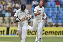Tim Southee, right, celebrates after taking the wicket of India's batsman Sachin Tendulkar, left, during the fourth day of their second cricket test match in Bangalore. Photo / Getty AP 