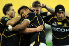 The Wellington Lions celebrating a try. Photo / Getty Images.