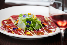 The beef carpaccio was billed as 'the original ... from Harry's Bar in Venice'. Photo / Michael Craig