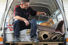 Carpet Court contractor Kerry Bell checks up on his uninvited hitchhiker at the Otago SPCA. Photo / Craig Baxter