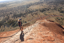 It's a long - and very steep - climb up and down Uluru. Photo / Colin Espiner