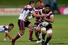 Fritz Lee of Counties Manukau drops the ball as he is tackled by Cory Aporo of North Harbour. Photo / Getty Images