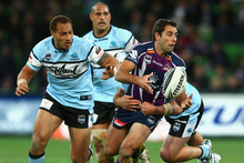 Cameron Smith of the Storm passes the ball during the match between the Melbourne Storm and the Cronulla Sharks. Photo / Getty Images