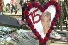Tourists from South Africa and Canada pay tribute to the late Princess Diana at a monument in Paris, marking 15 years since her death in a car accident in the French capital.