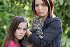 Jo Oxenham and her daughter Alyssa, 10, were devastated to learn their cat, Maverick, has eight gun pellets in him and will have to be put down. Photo / Mark McKeown