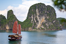 To experience the ethereal beauty of Halong Bay in Vietnam, a Chinese-style junk cruise is hard to beat. Photo / Creative Commons image by Flickr user David Conger