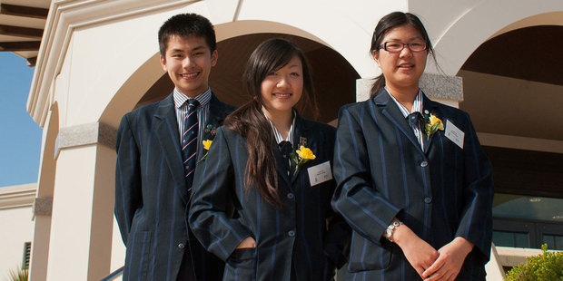 Selling off state assets is the best way of reducing debt, say Economics Challenge winners from Auckland's Macleans College (L to R) Andy Wang, Jennifer Xue and An Ran Chen. Photo / supplied