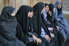 Women sit outside a mosque in Esfahan. Photo / Supplied