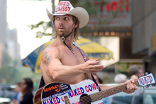 Times Square's Naked Cowboy, Robert Burck, has been entertaining tourists in New York for 13 years - but now he's facing some competition from a man calling himself the Naked Indian. Photo / Creative Commons image by Wikimedia user Ryan McGinnis