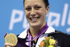 Sophie Pascoe holds her gold medal for the women's 100-metre butterfly S10 at the 2012 Paralympics games in London. Photo / AP