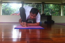 Chintamani Bali Retreat and Spa's yoga guru Budhi mid-stretch. Photo / Kristin Edge
