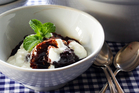 Chocolate sauce oozes from this pudding. Photo / Doug Sherring