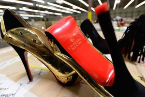 Christian Louboutin has won the right to trademark its red soled shoes. Photo / AFP