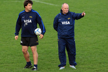 Graham Henry and coach Santiago Phelan talk during an Argentina training session. Photo / Getty