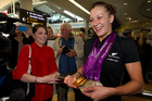 New Zealand Paralympian Sophie Pascoe with her three Gold and three Silver medals is greeted by her big sister Rebecca Richards, as she arrived back to Auckland. Photo / Brett Phibbs