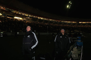 All Black forwards coach Mike Cron and Ben Franks wait for the lights to come back on after a powercut. Photo / Getty Images