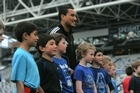 All Blacks and Highlanders' winger Hosea Gear passes on rugby tips during the All Blacks Rippa Rugby Experience event at Forsyth Barr Stadium in Dunedin yesterday to a new generation of rugby fans, who won a competition to meet and play with some of the All Blacks.