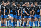 The All Black forwards pack gather during a New Zealand All Blacks captain's run at Forsyth Barr Stadium. Photo / Getty Images.