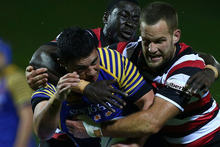 Sam Anderson-Heather of Otago is tackled by Adam Cathcart (R) and Daniel Adongo of Counties-Manukau during the round seven ITM Cup match between Counties Manukau and Otago. Photo / Getty Images.