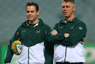 Johann Van Graan and Heyneke Meyer look on during a South Africa Springboks captain's run at Patersons Stadium. Photo / Getty Images.