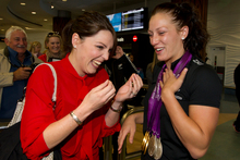 Paralympian Sophie Pascoe is greeted by sister Rebecca Richards at Auckland Airport yesterday. Photo / Brett Phibbs