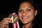 Valerie Adams' coach had her chocolate medal customised with a silver fern. Photo / Supplied