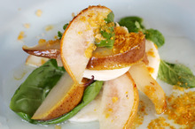 Pear and mozzarella salad with curried salt. Photo / Doug Sherring