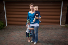 Nicola Drayton with Sam, 3, and 6-month-old Charlie on her driveway where their car was stolen. Photo / Richard Robinson