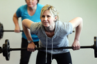 Reporter Rachel Grunwell pushes weights - and enjoys it - at City Fitness, Newmarket, Auckland. Photo / Doug Sherring