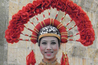 A woman in ethnic costume in Kunming, China. Photo / Graham Reid