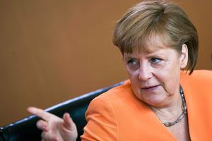The Godmother: German Chancellor Angela Merkel. Photo / AP