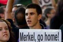 A protest against German Chancellor Angela Merkel's visit to Madrid. Photo / AP