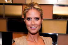 Heidi Klum poses before the Project Runway finale fashion show during Fashion Week. The model has spoken out about her split from Seal.