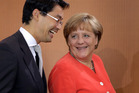 German Chancellor Angela Merkel (right) and German Economy Minister Philipp Roesler. Photo / AP
