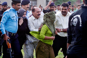 Rimsa Masih is escorted away after being freed on bail. Photo / AP