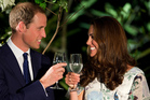 Britain's Prince William and his wife Catherine, the Duchess of Cambridge, make a toast in the honour of Queen Elizabeth's Diamond Jubilee at a British Gala reception in Singapore. Photo / AP