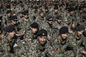 Afghan soldiers attend the ceremony for the handover of the US-run prison at Bagram to the Kabul Government. The West's future role in the country is less than certain.  Photo / AP