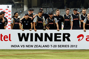 New Zealand celebrate a rare trophy after winning the two-match cricket Twenty20 series against hosts India. Photo / AP