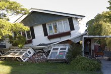 A collapsed house in Linwood.  Photo / David White
